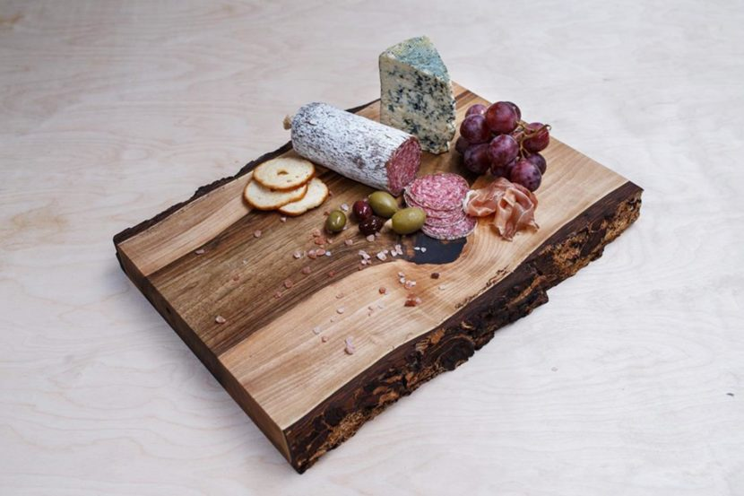 walnut wood wood cutting board with bark